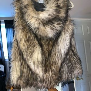 Amazing Free People faux furr vest with hood